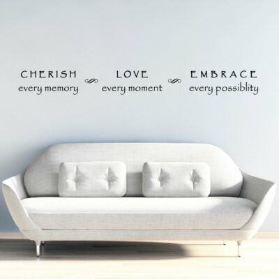 Cherish every memory love every moment embrace every possibility vinyl lettering saying in black on a light grey wall over a white couch