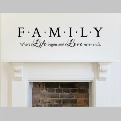 Family where life begins and love never ends vinyl lettering in black on a white wall over a mantel