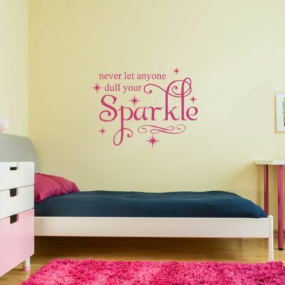 Never let anyone dull your sparkle vinyl lettering layout in hotpink applied to a yellow wall over a bed with a navy blanket and hotpink pillow and a hotpink shag carpet