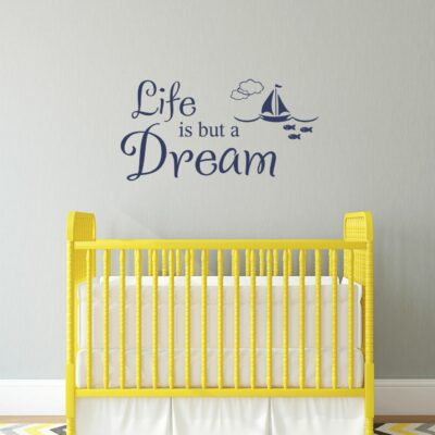 Life is but a dream vinyl lettering in navy applied to a light grey wall over a yellow crib