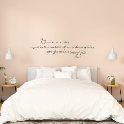 Once in a while right in the middle of an ordinary life love gives us a fairy tale written in charcoal vinyl lettering on a peach colored wall over a king size bed