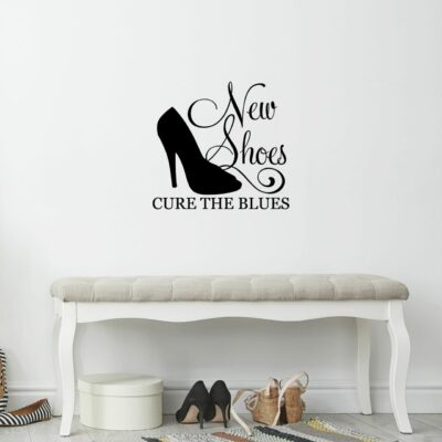 New shoes cure the blues written in black vinyl lettering on a white wall over a bench with some shoes placed underneath it