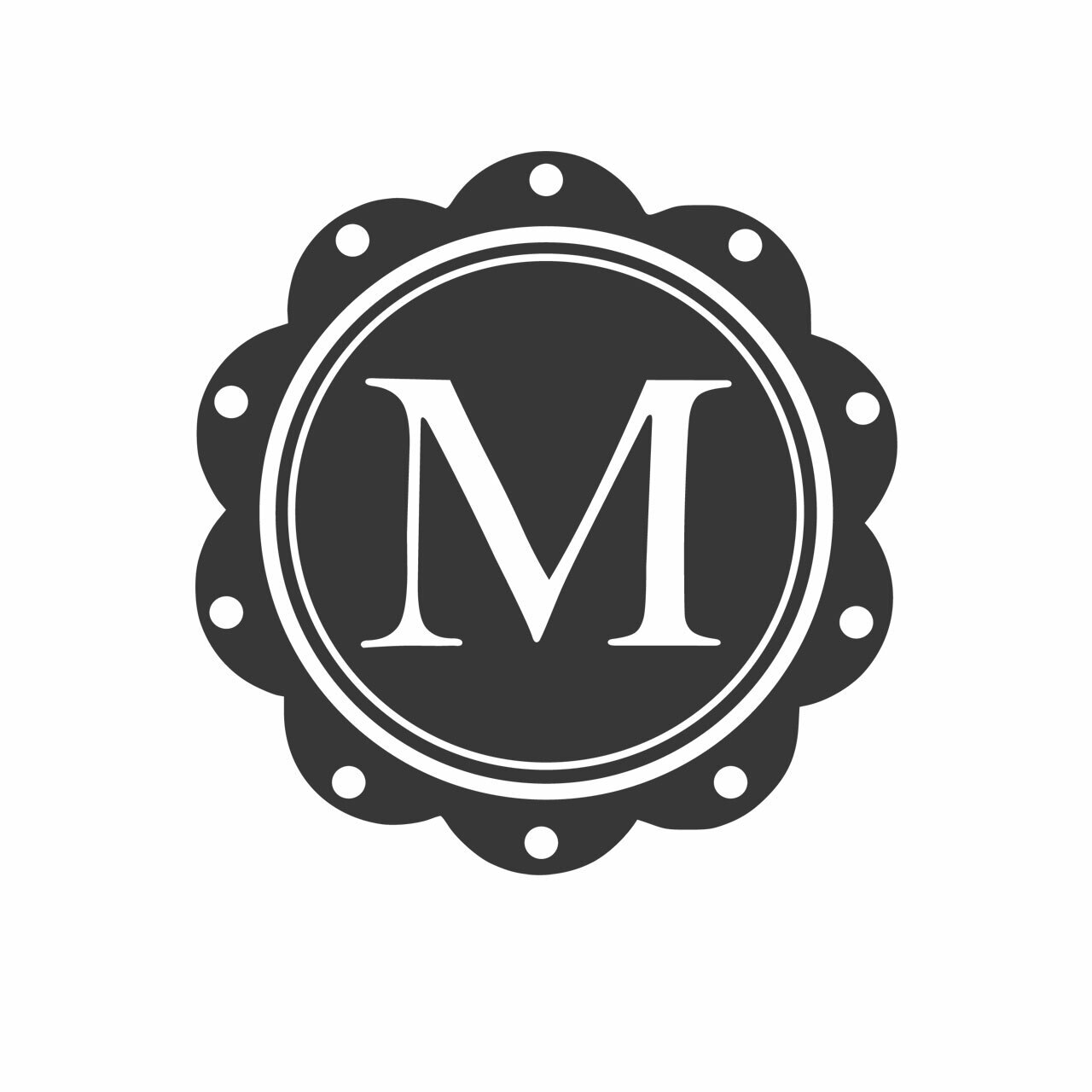 Charcoal grey single letter circular monogram with scalloped edges and the letter M in the middle on a white background