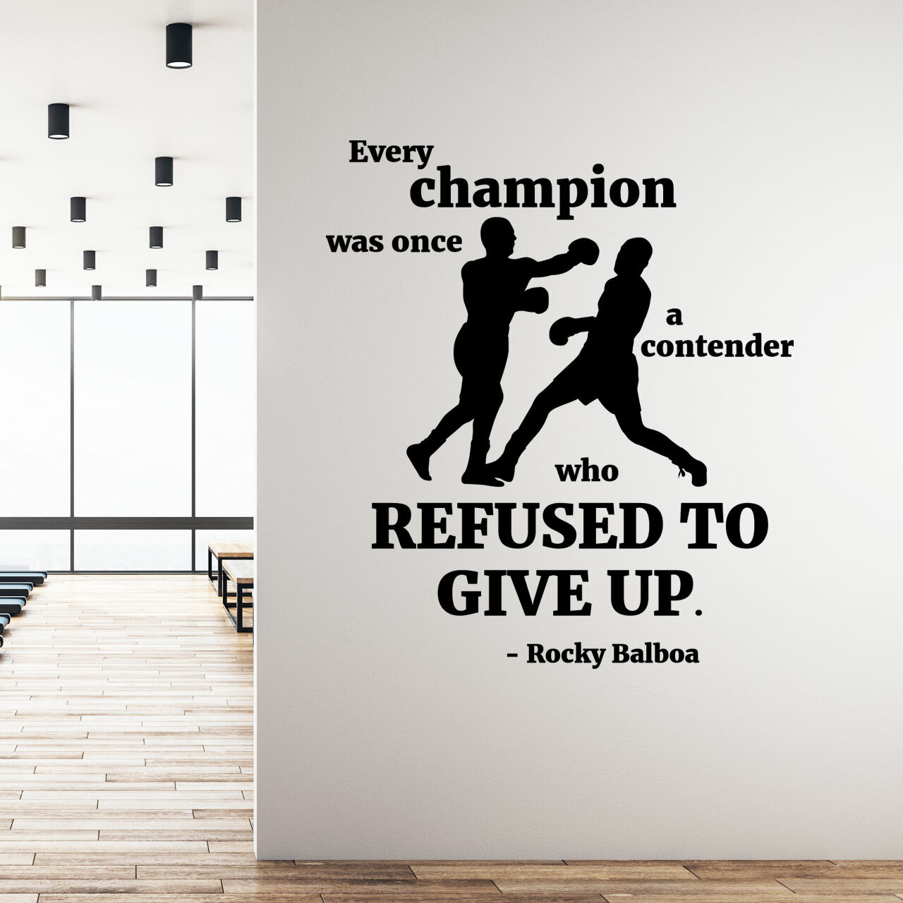Every champion was once a contender who refused to give up -Rocky Balboa layout on a white gym wall