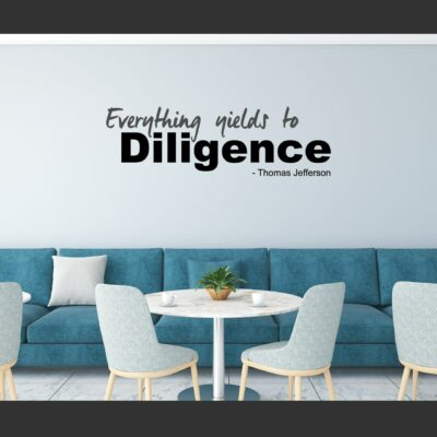 Everything yields to Diligence. -Thomas Jefferson written in grey and black vinyl lettering on a white wall over teal colored bench seating in a break room