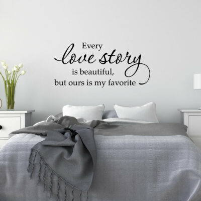 Every love story is beautiful but ours is my favorite vinyl saying on white wall over a bed