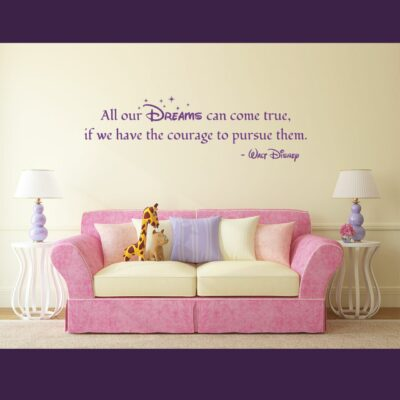 """""""All our Dreams can come true if we have the courage to pursue them."""" -Walt Disney written in violet vinyl lettering on a creme colored wall over a pink couch"""