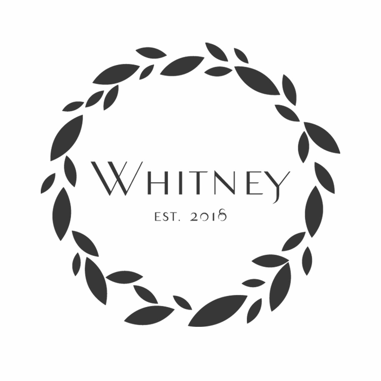 Leaf wreath around last name and year established on a white background