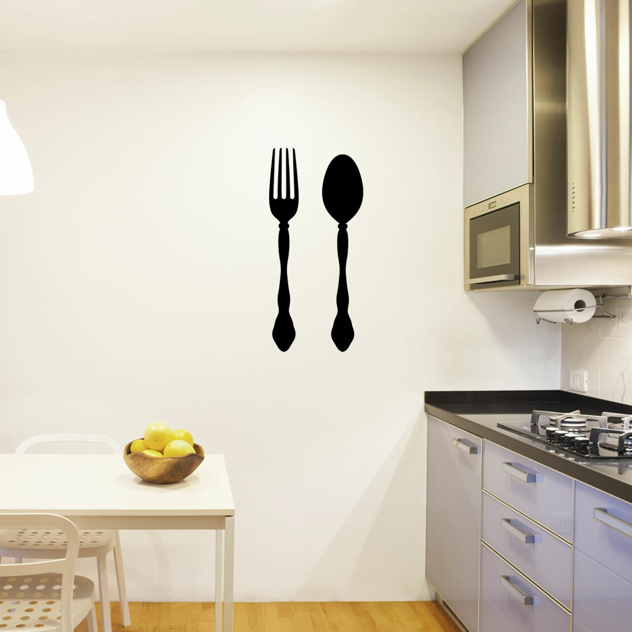 Fork & Spoon pictured side-by-side in black vinyl applied to a white kitchen wall