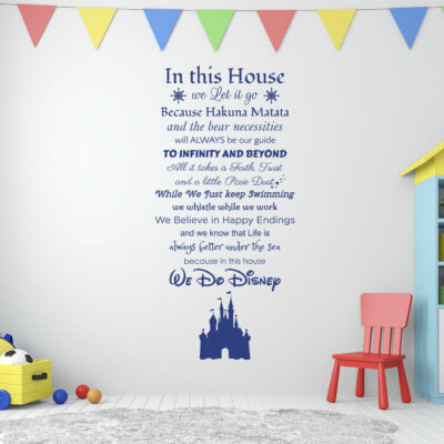 In this house we do disney quote on a white wall in children's playroom with small red chair some small balls and a pull toy